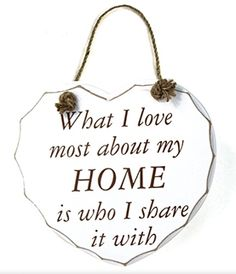 Hanging Heart - 'What I Love Most About My Home' White wooden hanging heart reading 'What I love most about my home is who I share it with'.     This shabby chic hanging heart plaque has a carved rustic edge.    Size - Height 17cm