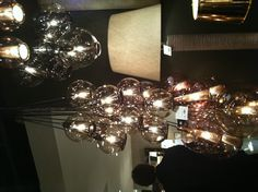 I've always loved this take on grouping pendants. At Arteriors.