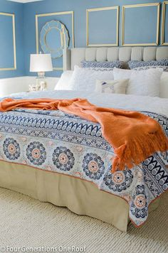 Have you ever thought of pairing navy and orange together? When I was creating our bedding ensemble above in our master bedroom, I decided to pull one color from the multi-colored blanket. The addition of the orange throw from HomeGoods was a perfect match.
