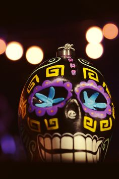 Wedding rings on top of a colorful #DayoftheDead ceramic skull or calavera. Mexico Wedding Photography by Quetzal Photo