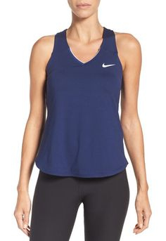 'pure' dri-fit racerback tank by Nike. Whether you're hitting one over the net or running around the track, this comfortable tank will keep you dry with moi...