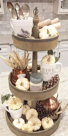 A fall vignette with a three-tier tray and a yummy Antique Candle Works candle!  This is perfect for a farmhouse kitchen!  Is it just me, or would this be an awesome setting for Thanksgiving?? Beautiful handmade soy candles - rustic decor for the modern farmhouse home. PC: IG - beckyshep_
