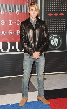 Justin Beiber from 2015 MTV Video Music Awards Red Carpet Arrivals  New hairstyle, Justin? A black leather jacket and jeans compete the singer's causal-cool look.