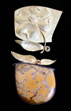 Linda Kindler Priest  |  Dogwood, a two part brooch ||  top: 14k repoussee, r2pt yellow sapphire. Bottom: 14k, 30pt yellow spahhire, dendritic opal, oxidized silver.  $3,800.00