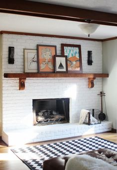 white-painted brick fireplace with wood mantle., white-painted brick fireplace with wood mantle. Wood Mantle Fireplace, Painted Brick Fireplaces, Brick Fireplace Makeover, White Fireplace, Fireplace Ideas, Mantle Art, Painting A Fireplace, Brick Fireplace Remodel, Painting Brick