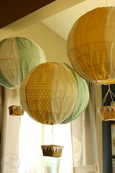 DIY Hot Air Balloons 5 by fabricpaperglue, via Flickr - Cover a large paper globe light and add drawstring & basket.