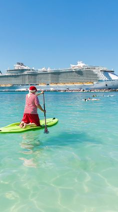"""Oasis of the Seas   Realizing he could bring no more joy than the cruisers on the Oasis of the Seas were already having, Santa thought, """"If you can't beat 'em, join 'em."""" So, he paddleboarded to his newly designed stateroom, took a relaxing nap and got a little color on the pool deck before dinner."""