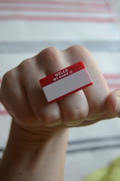 red name tag ring by alliterations on Etsy, $5.00
