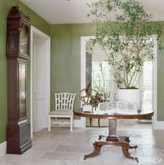 In entry, Dennis & Leen chair; seat in Interials ticking. Studio E wallpaper. Table, 18th-c. Limestone floor by Exquisite Surfaces.    - Veranda.com