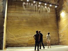 MONA; new museum. Beautiful natural sand rock as an inertia of the museum.This waterfall is one of the artworks for MONANISM exhibition. Julius Popp's Bit.fall drops several words each second.