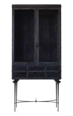 MADAM CURIO, curio cabinet in cerused black rift sawn white oak, and cast bronze base. 2 Glass-front doors, and 6 drawers. By Baker Hesseldenz Studio.