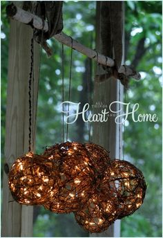 easy diy outdoor light, lighting, outdoor living, I ran the cord up the twine and connected it to a white extension cord that I hid between one of the loops of burlap ribbon which holds the branch the other end of the burlap ribbon is attached to the ceiling w eye hooks