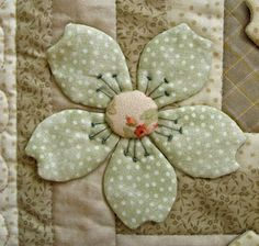 Fabric flower on quilt - see my 'Lots of Flower Templates' pin on this board for this design.