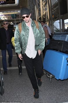 Robert Pattinson keeps it casual in his Alpha MA-1 at LAX.