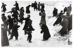 Robert Capa  - Childen playing in the snow, Hankou (China) 1938. Robert Capa is one of the most prolific and profound war photographers in history.