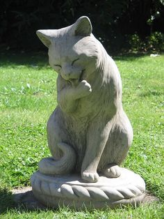 Large Licking Cat Statue