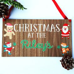 Personalised Family Christmas Sign  This beautifully printed sign is a wonderful keepsake. Made by our in house team, the Christmas at the sign is custom made for each customer and hand finished with red ribbon for hanging.  Buy for yourself, family or friends – this sign can be brought out each year.