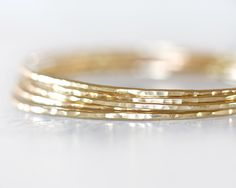 Gold Bangles / Stacking Bangles / Nu Gold Bracelets / Chic Fashion Fresh Finds Hand Hammered / Unique / Fashion Trend / Gold Trending by amywaltz on Etsy https://www.etsy.com/listing/127166323/gold-bangles-stacking-bangles-nu-gold