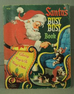 """Santa Claus painting sleigh. with kitten and puppy dog. Santa's Busy Busy Book. Things to do. Things to make. Santa's hat and coat/suit is felt as are the kitten's and puppy's hat. book measures 10 5/8"""" by 8 3/8"""". 