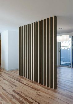 love this room divider in a home done by Austin architects Webber + Studio