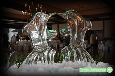 Ice sculpture of two dolphins representing the bride and groom