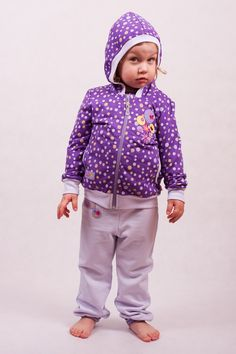 Blouse with hood. Made of 100% cotton. Zip fastening at front, two pockets. Pattern with yellow and violet dots and with beautiful motif on the front.     Sweatpants for girl with elastic band at waist. Made of 100% cotton. Elasticated ankles. Small motif on the front.