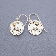 Ride off into the sunset. Light weight coin pendant bike earrings. Sterling silver and brass sun motif. http://www.liftyoursole.com/collections/triathlon-earrings?page=2