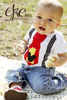 Mickey Mouse Birthday Tie and Suspenders Onesie for Baby Boy First Birthday Disney Clothing Birthday Party Little Man Tie Outfit. $19.95, via Etsy.