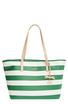 This cute green and white striped Kate Spade tote is here just in time for spring.