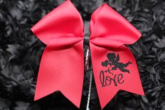 """Valentine's Collection """"Cupid Love"""" bow. Beautiful red 3"""" cheer bow with black glitter cupid.  Visit my etsy store https://www.etsy.com/shop/DanisCuties?ref=search_shop_redirect"""