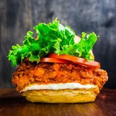 Spicy Buffalo Ranch Chicken Burgers. Fried Chicken, Hot Sauce and A Sandwich Walk Into A Bar... Fried chicken may be the definition of comfort food—crunchy and absolutely delicious. Toss it in some Buffalo wing sauce and you have a game-day favorite. Make it a sandwich and you have hit a high. This spicy crispy chicken sandwich topped with homemade ranch dressing is a guaranteed hit.
