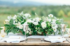 Table arrangement: low and wide, with white and foliage | Whimsical Floral Design // Emily Sacco Photography // via Magnolia Rouge