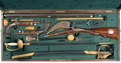 Graniture of a Shotgun, Two Swords and a Brace of Pistols from Vincent & Sons of Perigueux, France A