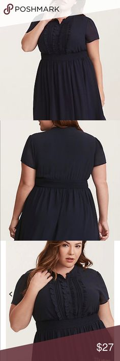 Navy Chiffon Ruffled Skater Dress A prim and proper dress that has some subtly sexy attitude. The smocked waist provides a tailored, nipped-in look, showing off your curves. The ruffled button front is all polite. Size 1. Worn once. torrid Dresses