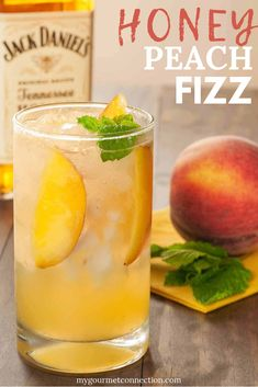 Made with Jack Daniel's Tennessee Honey, muddled peaches, fresh mint and a splash of sparkling lemon-lime soda, this light, refreshing peach cocktail is perfect for summer drinking! #cocktail #cocktailrecipe #honeypeachfizz #mygourmetconnection