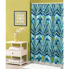 Enliven your bathroom with this vibrant ikat-style pattern, reminiscent of peacock feathers, in shades of turquoise, blue and green.