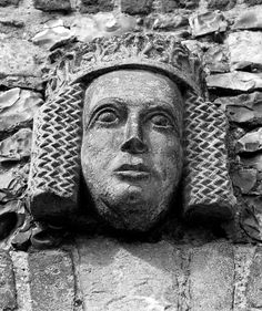 One of the Medieval Heads above the windows on the poorhouse at Framlingham Castle [Suffolk]. Photographer says they survived from the earlier interior castle buildings, and he has no idea who they are meant to be.