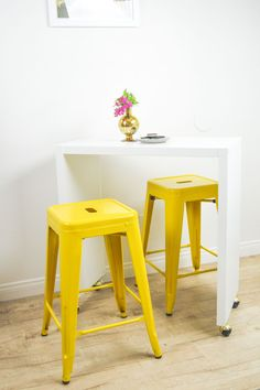 Use this simple IKEA hack to create a DIY rolling kitchen island or bar that serves a multitude of purposes, including dining and working!