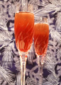 A Winter's Solstice Cocktail (Pomegranate Mimosa with Cinnamon and Orange Peel) from It's Not Easy Eating Green.