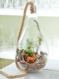 In a rope-suspended teardrop, this cute deer finds a home in a forest-inspired backdrop.