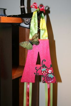 """Letter """"A"""" Bow holder. Cute way to organize all of your hair bows."""