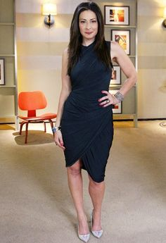 Stacy London shows how revealing less skin is more. I love the tulip bottom of this dress! -e.g.