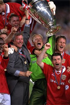 "Treble triumph: Ferguson finally gets his hands on the ""Holy Grail"" to end one of the greatest seasons any football club has experienced in May, 1999. One of SAF's favourite United photographs, auctioned for Unicef."