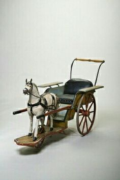 Courtesy of The Royal Armoury Toy horse and carriage, used by crown prince Gustav Adolf in the