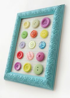 Make budget button art with a dollar store frame, scrapbook paper and buttons with your stash.