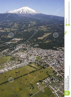 Aerial view of the city on the hillside deel Pucon Villarrica volcano