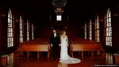 Couple photos in church, fit and flare wedding dress