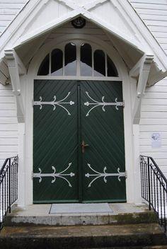 Door to Voll church in Måndalen in Rauma, Norway