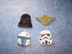 I used spring loaded Star Wars cookie cutters purchased on eBay to create these Christmas tree ornaments made out of air dry clay. I painted them with acrylic paint and using Google images as my color guides. I imbedded hooks in the back of them, and brushed a slightly diluted amount of Weld Bond glue to seal them and create a shine effect.