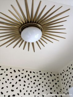 This gorgeous sunburst ceiling light was created using a Hampton Bay light fixture and a Martha Stewart Living mirror--both from Home Depot. Click through to see how Pam of Simple Details (@Pam @ simple details) created it.